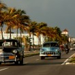 Old cars on malecon in Cienfuegos, Cuba - Stock Photo