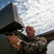 Soldier presents electronic rocket launcher — Stock Photo
