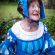 Older lady in medieval costume — Stock Photo