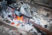 Iron stick in hammer furnace — Stock Photo
