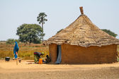 Mother and dother in front of their house in Senegal, Africa — Stock Photo