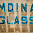 Stock Photo: Mdinglass sign made out of famous glass manufactured in this city
