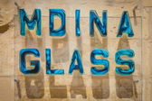 Mdina glass sign made out of famous glass manufactured in this city — Stock Photo