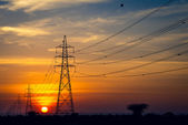 Transmission power line in sunset concept for green eco energy — Stock Photo