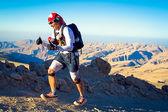 Unidentified runner running in mountains near Qalhat on extreme marathon — Stock Photo