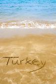 Turkey written on sandy beach — Stock Photo