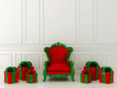 Red chair with gifts — Stock Photo