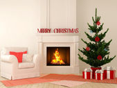 Christmas fireplace with chair and tree — Stock Photo