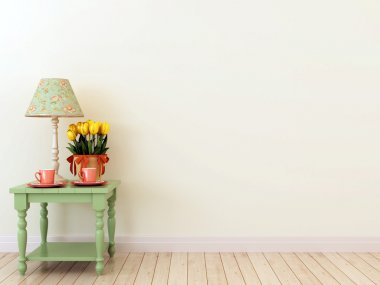 Green side table with the decor in the interior