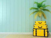 Yellow bags and palm tree — Stock Photo