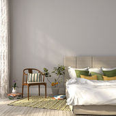 Beige bed with green decor — Stock Photo