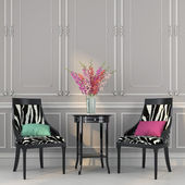 Two chairs with zebra print and a table — 图库照片