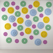 Beautiful colored rosettes on a white wall — Stock Photo