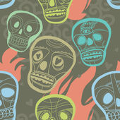 Seamless pattern with skulls and fire — Stock Vector