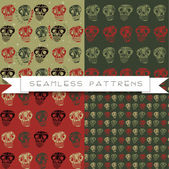 Set of four skull patterns — Stockvektor