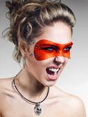 Girl in orange leather mask screaming — Stock Photo