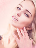 Hot young blond in pink lights — Stock Photo