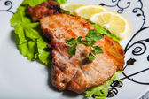 Meat with salad and lemon — Stock Photo