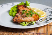 Grilled pork with salad and lemon — Stock Photo