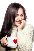 Pretty girl with cup of tea — Stock Photo