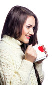 Cute girl with cup of tea — Stock Photo