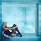 Sexy curly blonde sit on near window in corset — Stock Photo