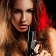 Portrait of woman with pistol — Stock Photo