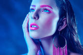 Cutie woman with pink make up looking up — Stock Photo