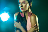 Female with pink make up looking away in studio — Stock Photo