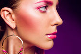Half face portrait of female with pink make up — Stock Photo