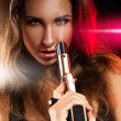 Portrait of sexy young adult woman with gun — Stock Photo #27523341