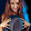 Shy girl hiding boobs behind a hat — Stock Photo