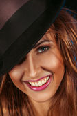Female on hat and toothy smile — Stock Photo