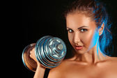 Portrait of girl with dumbbells in hand — Stock Photo