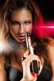 Portrait of sexy young adult woman with gun — Stock Photo