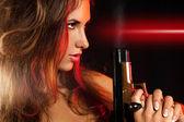 Profile portrait of nice female with gun — Stock Photo