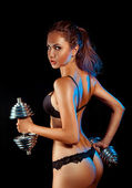 Vertical photo of sports woman in black lingerie and dumbbells — Stock Photo