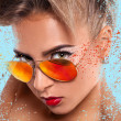 Elegance portrait of woman in sunglasses with abstractions — Stock Photo #29569915