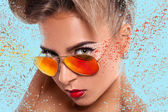 Elegance portrait of woman in sunglasses with abstractions — Stock Photo
