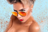 Portrait of young adult woman in sunglasses with abstracton — Stock Photo