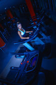Athletic girl on treadmill at gym — Stock Photo