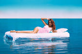 Sensual photo of female lying on bed in sea — Stok fotoğraf