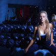 Caucasian fitness model looking at camera in gym — Stock Photo #33857571