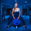 Fitness model in gym — Stock Photo #33857589