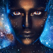 Stock Photo: Space make up on female face