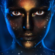 Stock Photo: Vertical photo of pretty womwith black face art