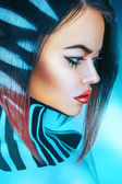 Profile portrait of voluptuous woman in cold tones — Stock Photo