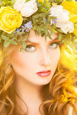 Beautiful woman with wreath on hair looking at camera — Stock Photo