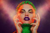Caucasian woman with creative makeup in studio — Stock Photo