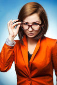 Cute business woman with glasses and jacket — Stock Photo